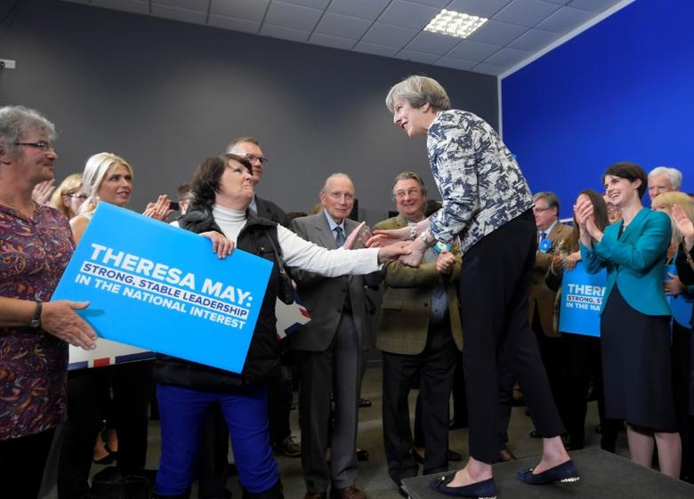 Britain's Prime Minister Theresa May greets Conservative Party supporters after giving an election campaign speech in Norwich, June 7, 2017. REUTERS/Toby Melville - RTX39FNQ