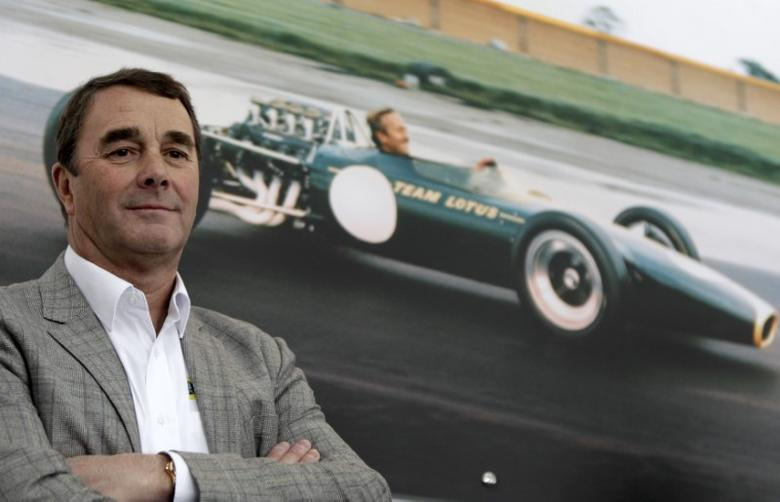 British former Formula 1 driver Nigel Mansell attends the official opening ceremony of the first Lotus car showroom near Bucharest February 24, 2011. REUTERS/Bogdan/Files