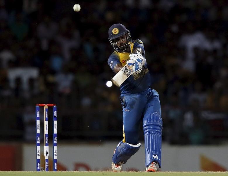 Sri Lanka's Chamara Kapugedera hits a six during their second Twenty 20 cricket match against Pakistan in Colombo August 1, 2015. REUTERS/Dinuka Liyanawatte