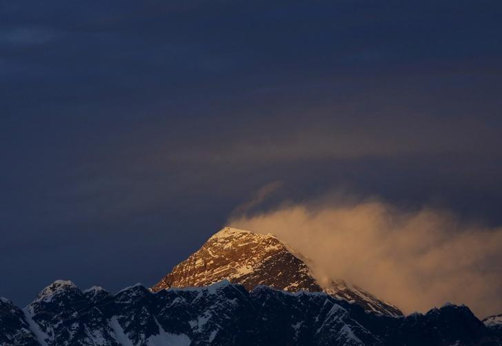 Light illuminates Mount Everest, during the in Solukhumbu District also known as the Everest region, in this picture taken November 30, 2015. REUTERS/Navesh Chitrakar/File Photo