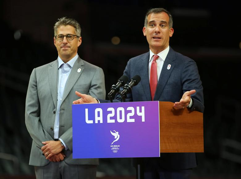 FILE PHOTO: Los Angeles Mayor Eric Garcetti speaks along with LA 2024 Chairman Casey Wasserman during a news conference following three days of meetings and tours with the International Olympic Committee (IOC) Evaluation Commission as part of LA 2024's  bid for the Summer 2024 Olympic Games in Los Angeles, California, U.S.,  May 12, 2017.   REUTERS/Mike Blake