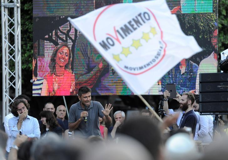 Alessandro Di Battista of the 5-Star Movement gestures as he speaks during a rally in Palermo, Italy June 4, 2017.  REUTERS/Guglielmo Mangiapane