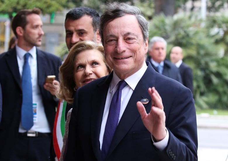 FILE PHOTO: European Central Bank President Mario Draghi (R) and his wife (L) arrive at the Petruzzelli Theatre during a G7 for Financial ministers in the southern Italian city of Bari, Italy May 11, 2017. REUTERS/Alessandro Bianchi/File Photo