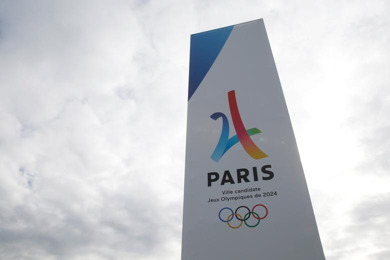 FILE PHOTO: The logo of the Paris candidacy for the 2024 Olympic and Paralympic Games is seen at the entrance of the Le Bourget exhibition center, proposed site of the media village and the press center, during the press tour of the International Olympic Committee Evaluation Commission, in Le Bourget, near Paris, May 15,  2017. REUTERS/Gonzalo Fuentes