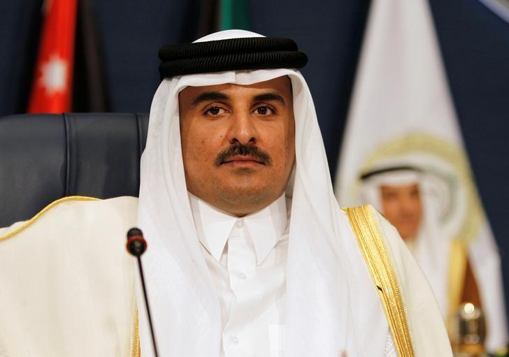 FILE PHOTO: Emir of Qatar Sheikh Tamim bin Hamad al-Thani attends the 25th Arab Summit in Kuwait City, March 25, 2014. REUTERS/Hamad I Mohammed/File Photo