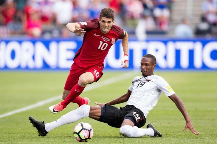 Jun 8, 2017; Commerce City, CO, USA; Trinidad & Tobago midfielder Kevan George (19) defends against United States midfielder Christian Pulisic (10) in the first half at Dick's Sporting Goods Park. Mandatory Credit: Isaiah J. Downing-USA TODAY Sports