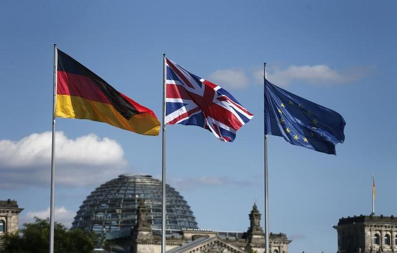 German, British and European Union flags fly in front of the Reichstag building in Berlin, Germany July 20, 2016. REUTERS/Hannibal Hanschke