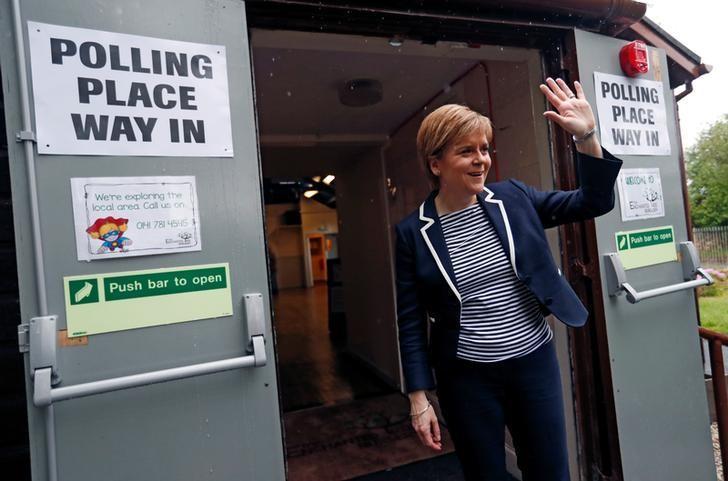 Nicola Sturgeon, First Minister of Scotland, waves after voting in Glasgow, Britain June 8, 2017. REUTERS/Russell Cheyne