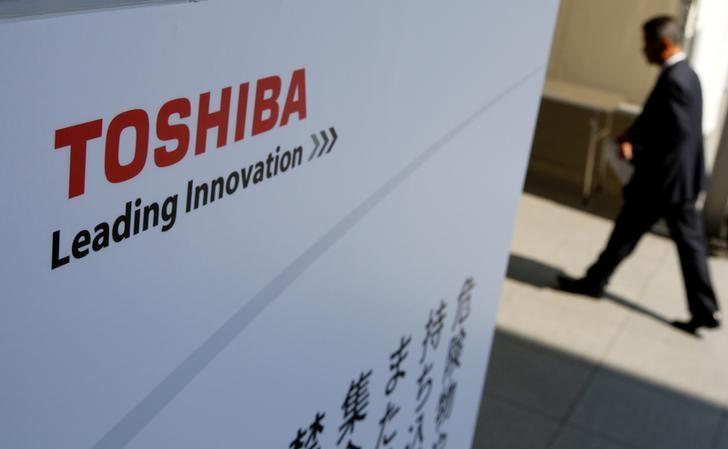 The logo of Toshiba is seen as a shareholder arrives at Toshiba's extraordinary shareholders meeting in Chiba, Japan  March 30, 2017.   REUTERS/Toru Hanai/File Photo