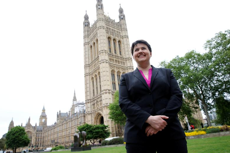 FILE PHOTO: Ruth Davidson, the leader of the Conservative Party in Scotland, poses for photographers outside the Houses of Parliament in central London, Britain May 15, 2017.  REUTERS/Stefan Wermuth/File Photo
