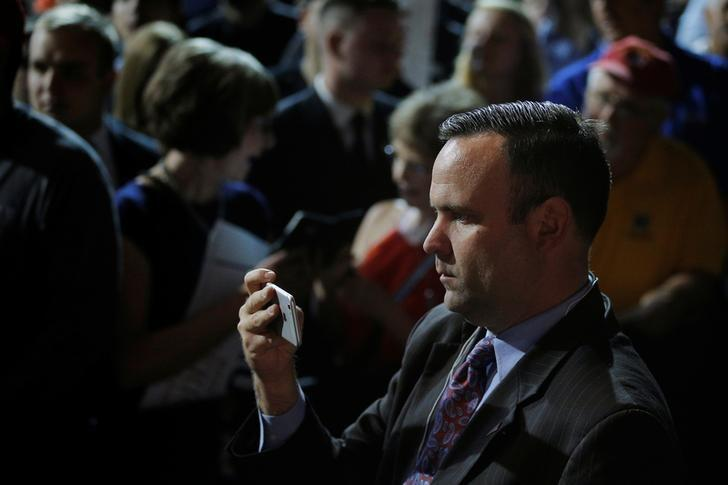 Dan Scavino, director of social media and senior advisor to U.S. Republican presidential candidate Donald Trump, records Trump greeting audience members at a campaign rally in Bangor, Maine June 29, 2016. REUTERS/Brian Snyder/Files