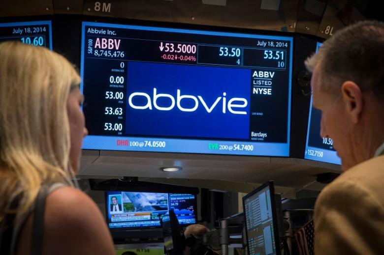 FILE PHOTO --  A screen displays the share price for pharmaceutical maker AbbVie on the floor of the New York Stock Exchange July 18, 2014.  REUTERS/Brendan McDermid/File Photo