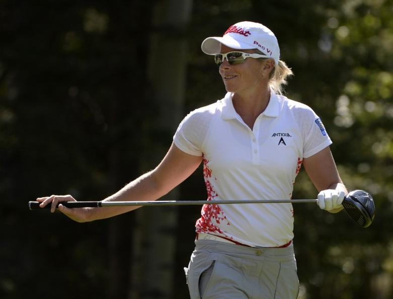 FILE PHOTO: Aug 26, 2016; Calgary, Alberta, CAN; Alena Sharp of Canada walks off the 6th tee during the second round at Priddis Greens Golf and Country Club. Mandatory Credit: Eric Bolte-USA TODAY Sports  / Reuters Picture Supplied by Action Images