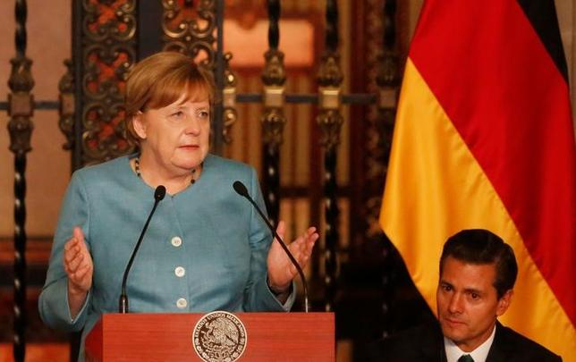 Germany's Chancellor Angela Merkel delivers a speech next to Mexico's President Enrique Pena Nieto before dinner at National Palace in Mexico City, Mexico June 9, 2017. REUTERS/Carlos Jasso
