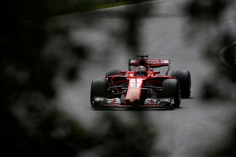 Formula One - F1 - Canadian Grand Prix - Montreal, Quebec, Canada - 10/06/2017 - Ferrari's Sebastian Vettel in action during the third free practice session. REUTERS/Chris Wattie