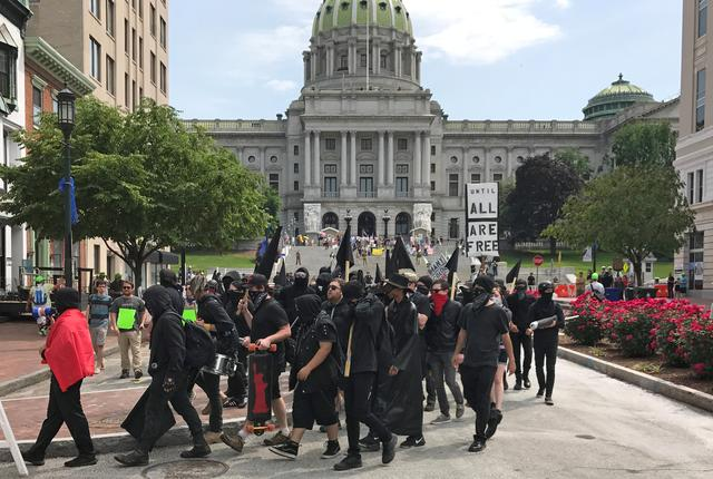 Demonstrators march during an Anti-Sharia rally in front of the State Capitol building in Harrisburg, Pennsylvania, U.S., June 10, 2017.  REUTERS/David DeKok