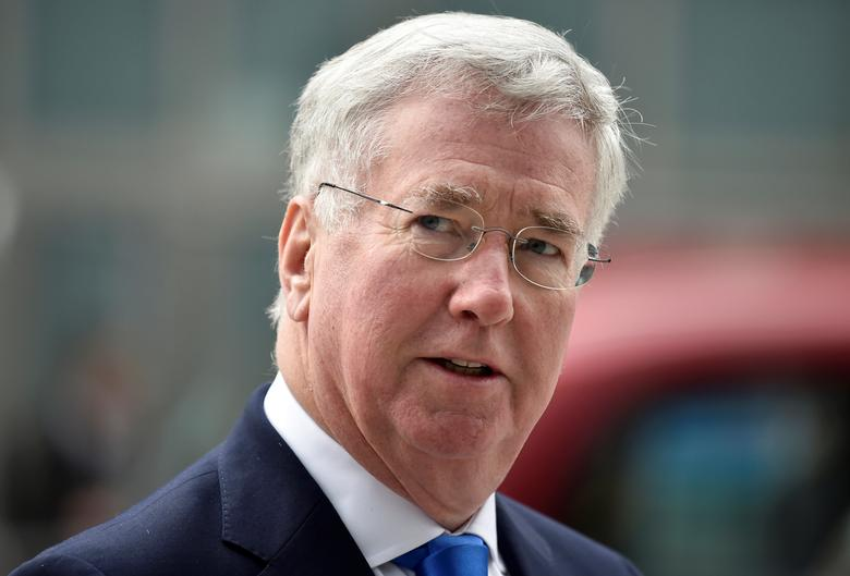 FILE PHOTO: British Defence Secretary Michael Fallon arrives at the National Cyber Security Centre in London, Britain, February 14, 2017. REUTERS/Hannah McKay/File Photo          FOR EDITORIAL USE ONLY. NO RESALES. NO ARCHIVES.