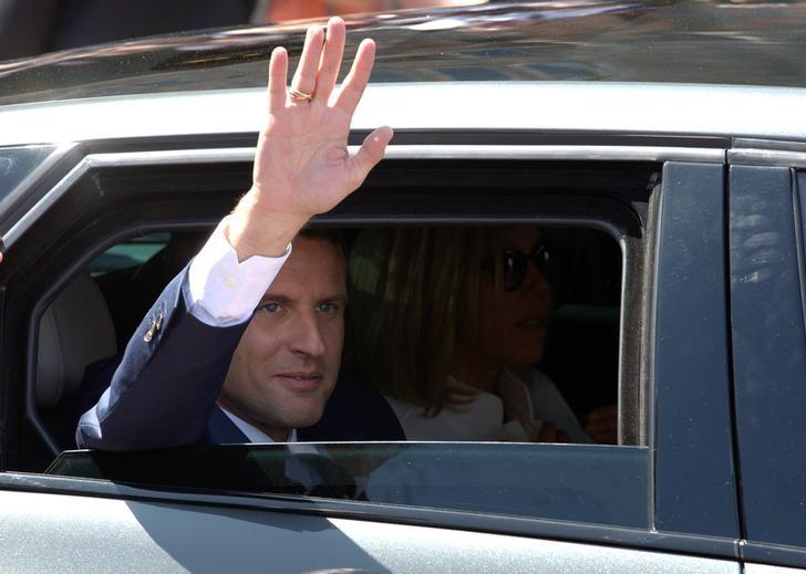 French President Emmanuel Macron leaves the polling station after voting in the first of two rounds of parliamentary elections in Le Touquet, France, June 11, 2017. REUTERS/Philippe Wojazer