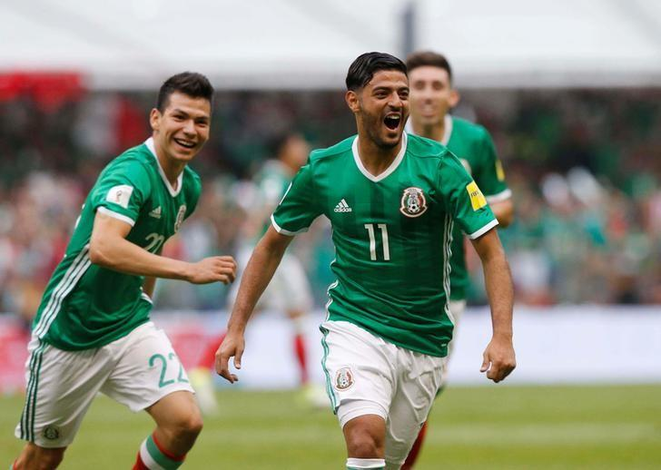 Football Soccer - Mexico v U.S. - World Cup 2018 Qualifiers - Azteca Stadium, Mexico City, Mexico - 11/6/17- Mexico's Carlos Vela (L) celebrates with teamamates after scoring a goal. REUTERS/Henry Romero