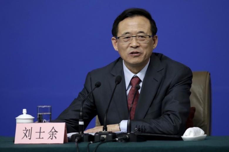 FILE PHOTO - Liu Shiyu, Chairman of China Securities Regulatory Commission (CSRC), attends a news conference on the sidelines of the National People's Congress (NPC) in Beijing, China, March 12, 2016. REUTERS/Jason Lee /File Photo