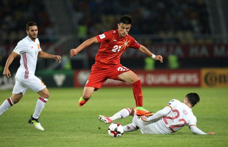 Football Soccer - FYR Macedonia v Spain - 2018 World Cup Qualifying European Zone - Group G - Philip II Arena, Skopje, FYR Macedonia - June 11, 2017   Macedonia's Elif Elmas in action with Spain's Isco    Reuters / Stoyan Nenov