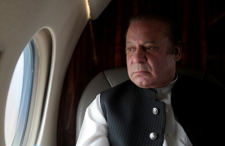 Pakistani Prime Minister Nawaz Sharif looks out the window of his plane after attending a ceremony to inaugurate the M9 motorway between Karachi and Hyderabad, Pakistan February 3, 2017. REUTERS/Caren Firouz/Files