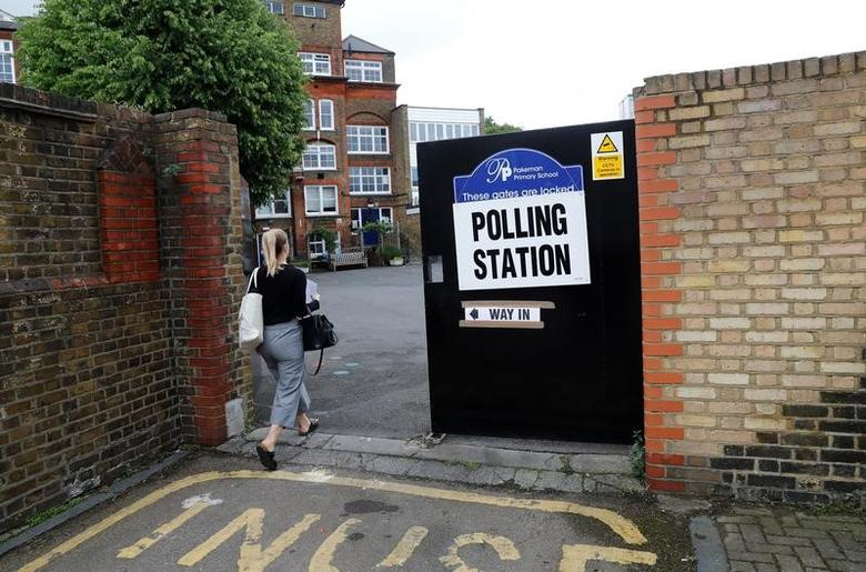 FILE PHOTO: A voter arrives at a polling station in London, Britain June 8, 2017. REUTERS/Stefan Wermuth