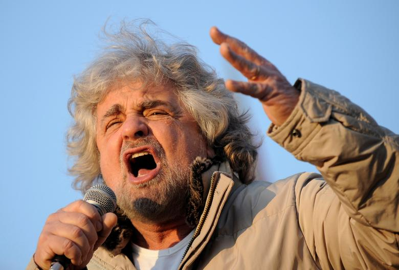 Five-Star Movement leader and comedian Beppe Grillo gestures during a rally in Turin, Italy February 16, 2013. REUTERS/Giorgio Perottino/Files