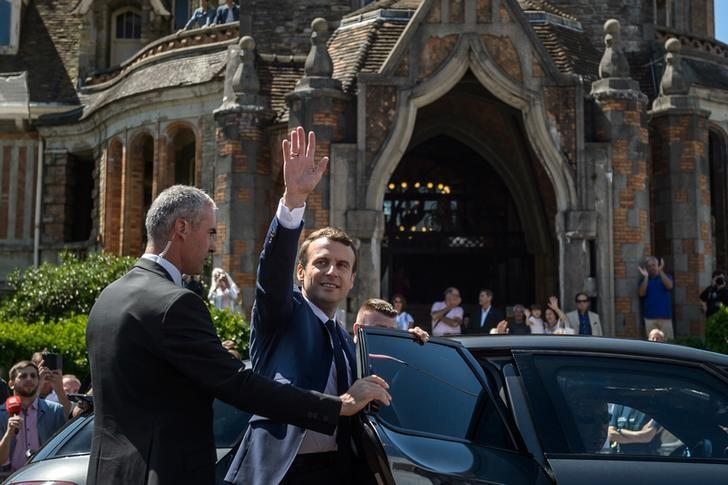 French President Emmanuel Macron leaves the polling station after voting in the first of two rounds of parliamentary elections in Le Touquet, France, June 11, 2017.    REUTERS/Christophe Petit Tesson/Pool