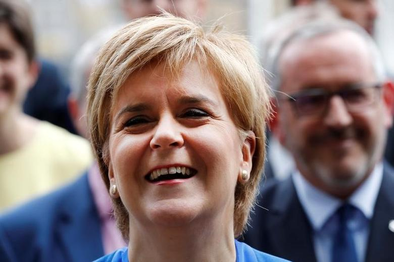 Scotland's First Minister and leader of the Scottish National Party Nicola Sturgeon smiles as she poses with her party's Members of Parliament in London, Britain, June 12, 2017. REUTERS/Stefan Wermuth
