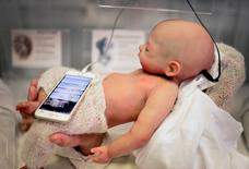 """A Babyclon Animatronic baby is displayed at the Bilbao Reborn Doll Show, a trade fair featuring hyperrealist silicone and vinyl babies, known as """"Reborns"""", in Bilbao, northern Spain June 11, 2017. REUTERS/Vincent West"""