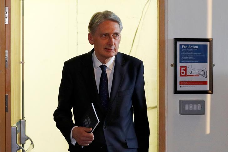 FILE PHOTO: Britain's Chancellor of the Exchequer Philip Hammond arrives at Prime Minister Theresa May's election manifesto launch in Halifax, May 18, 2017. REUTERS/Phil Noble