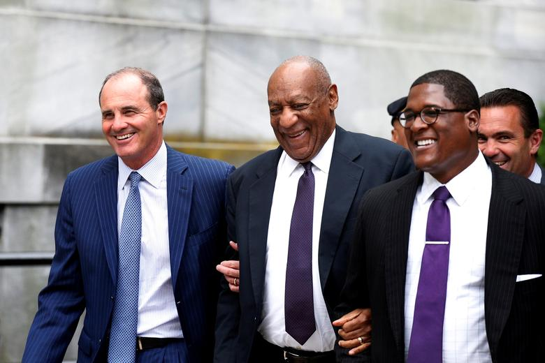 Actor and comedian Bill Cosby leaves with his spokesman Andrew Wyatt (R) and lawyer Brian McMonagle after the second day of his sexual assault trial at the Montgomery County Courthouse in Norristown, Pennsylvania. REUTERS/Brendan McDermid