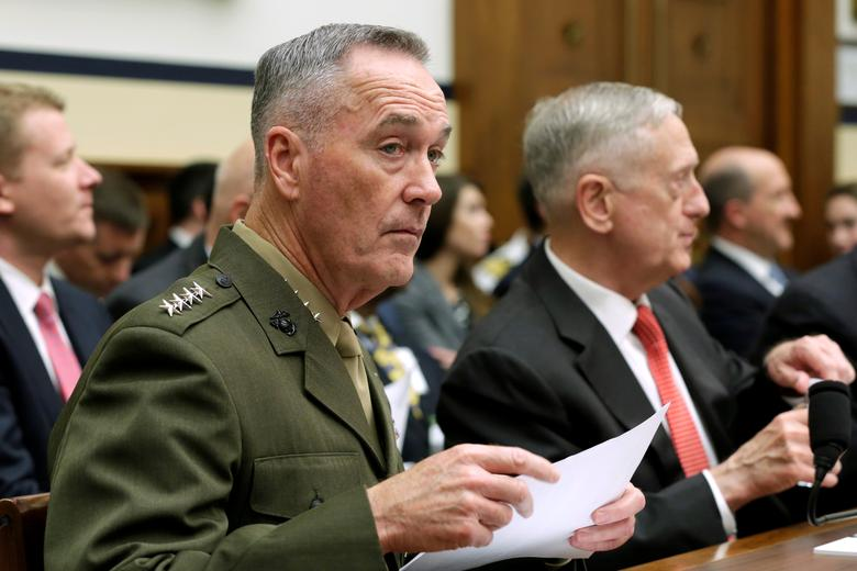 U.S. Defense Secretary James Mattis (R) and Joint Chiefs Chairman Marine Gen. Joseph Dunford wait to testify before a House Armed Services Committee hearing on the Pentagon's budget priorities on Capitol Hill in Washington, U.S., June 12, 2017. REUTERS/Yuri Gripas