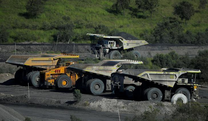 FILE PHOTO: A loaded coal truck passes others inside coal giant Rio Tinto's Hunter Valley operations in Lemington, north of Sydney, Australia, April 9, 2017.   REUTERS/Jason Reed/File Photo