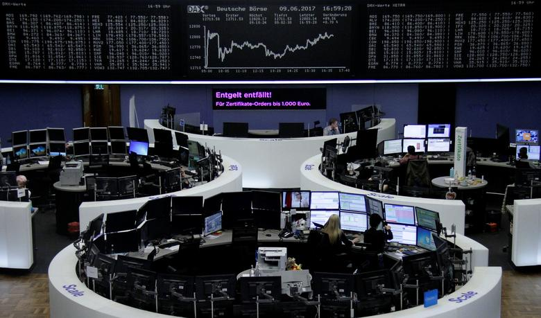 Traders work in front of the German share price index, DAX board, at the stock exchange in Frankfurt, Germany, June 9, 2017. REUTERS/Staff/Remote