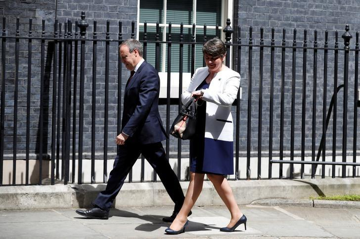 The leader of the Democratic Unionist Party (DUP), Arlene Foster, and the Deputy Leader Nigel Dodds, arrive at 10 Downing Street before talks with Britain's Prime Minister Theresa May, in central London, Britain June 13, 2017.  REUTERS/Phil Noble