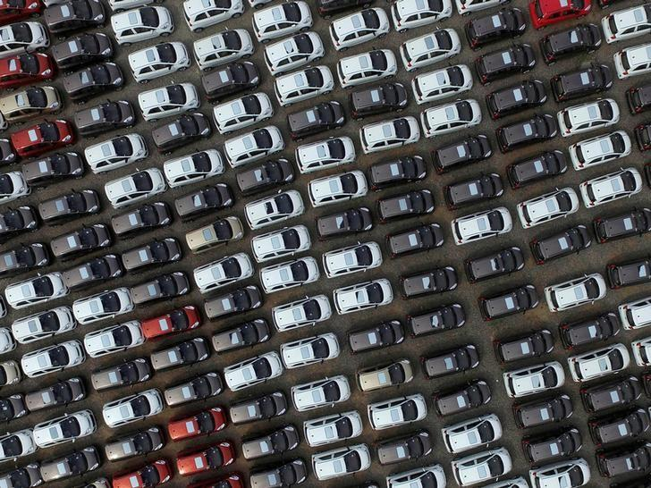 Electric cars are seen at a parking lot of an automobile factory in Xingtai, Hebei province, China April 26, 2016. REUTERS/Stringer/File Photo