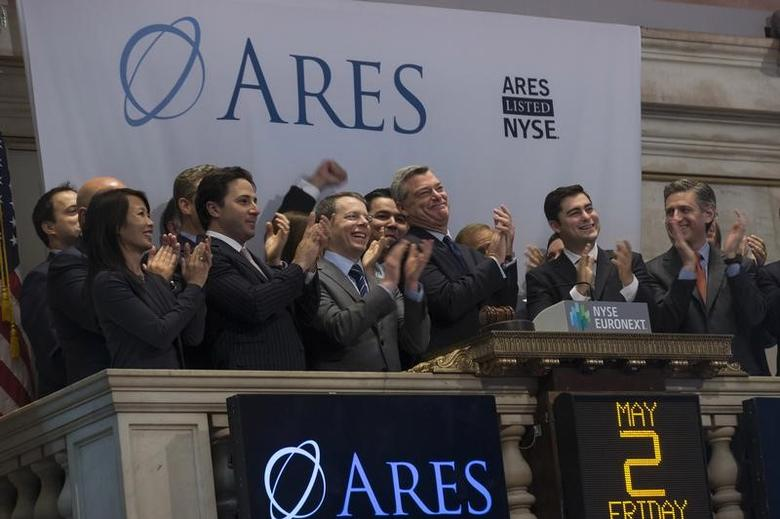 Ares Management LP CEO and co-founder Tony Ressler (3rd R, front) and company guests ring the opening bell at the New York Stock Exchange May 2, 2014. REUTERS/Brendan McDermid