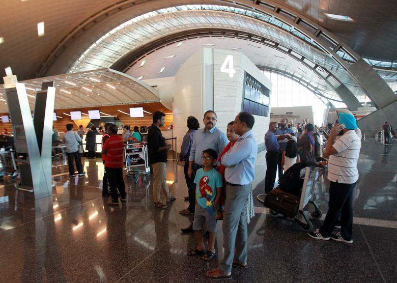 Passengers stand at Hamad International Airport in Doha, Qatar June 12, 2017. REUTERS/Naseem Zeitoon