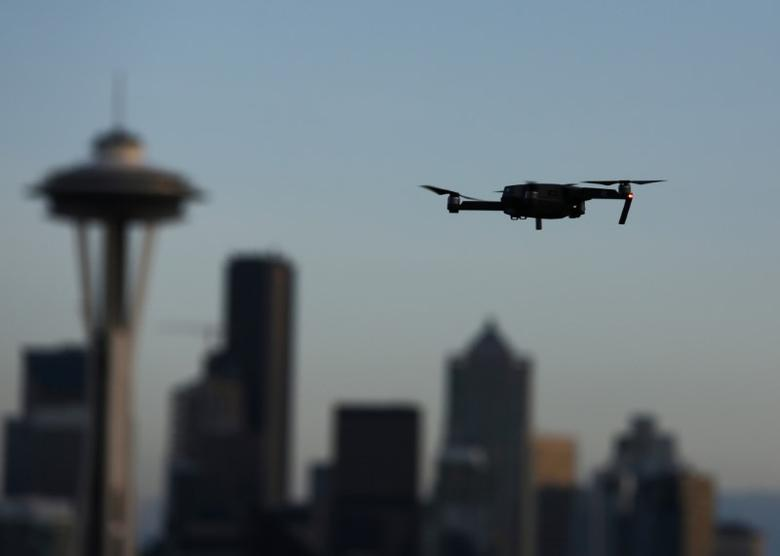 A drone hovers at a viewpoint overlooking the Space Needle and skyline of tech hub Seattle, Washington, U.S. February 11, 2017.  REUTERS/Chris Helgren