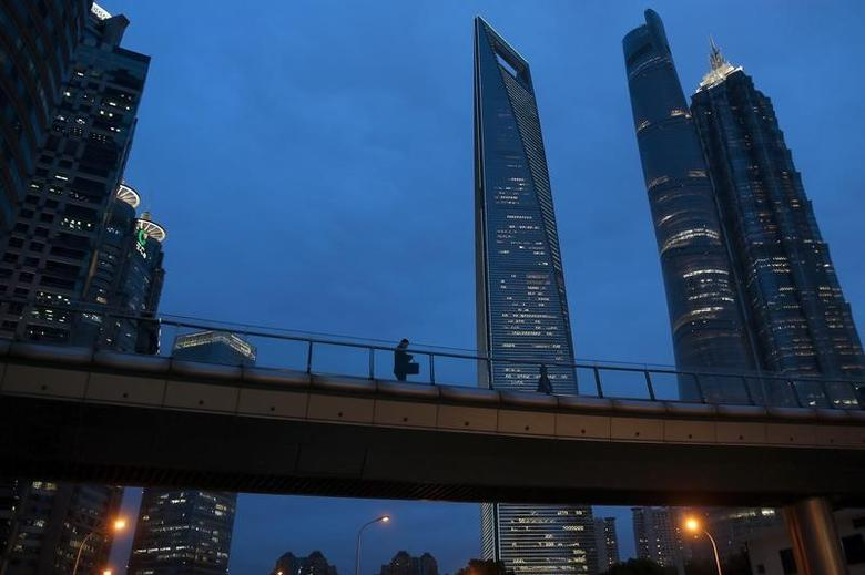 A man walks on a bridge in the financial district of Pudong in Shanghai, China, April 5, 2016. REUTERSAly Song