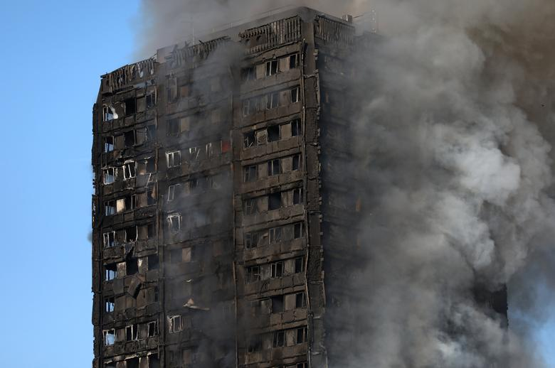 Smoke billows as firefighters tackle a serious fire in a tower block at Latimer Road in West London, Britain June 14, 2017. REUTERS/Neil Hall