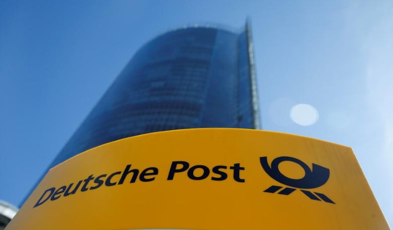 FILE PHOTO: A Deutche Post sign stands in front of the Bonn Post Tower, the headquarters of German postal and logistics group Deutsche Post DHL, in Bonn, Germany March 11, 2015.         REUTERS/Wolfgang Rattay/File Photo
