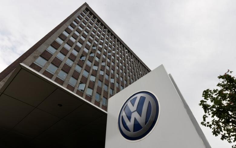 A VW logo is seen in front of the main building of the Volkswagen brand at the Volkswagen headquarters during a media tour to present Volkswagen's so called ''Blaue Fabrik'' (Blue Factory) environmental program, in Wolfsburg, Germany May 19, 2017. REUTERS/Fabian Bimmer - RTX36N7O