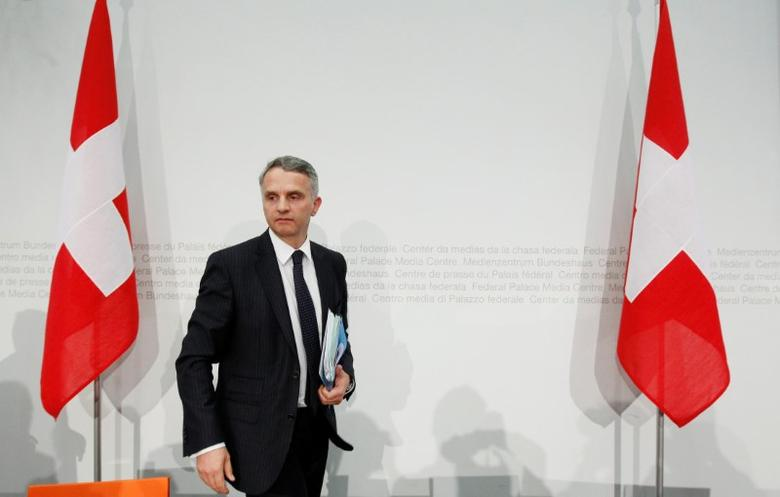 FILE PHOTO - Swiss Foreign Minister Didier Burkhalter leaves after a news conference after the weekly meeting of the Federal Council in Bern February 1, 2012. REUTERS/Pascal Lauener/File Photo