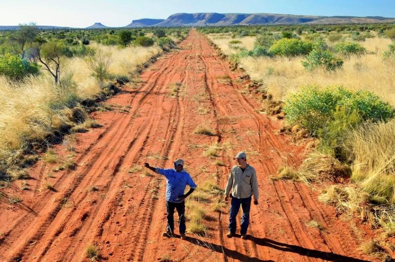 A supplied image of Wilpiri ranger Duncan Jangala (L) and Australian Wildlife Conservancy sanctuary manager Joe Schofield standing in the area where an electrified enclosure will be built on a former cattle property, covering around 9,450 hectares, at the Newhaven Wildlife Sanctuary located near Alice Springs in the Northern Territory, central Australia, June 6, 2017. Australian Wildlife Conservancy-Wayne Lawler/Handout via REUTERS