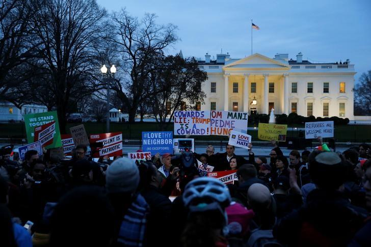 FILE PHOTO: Demonstrators rally against the Trump administration's new ban against travelers from six Muslim-majority nations, outside of the White House in Washington, U.S. March 6, 2017. REUTERS/Jonathan Ernst