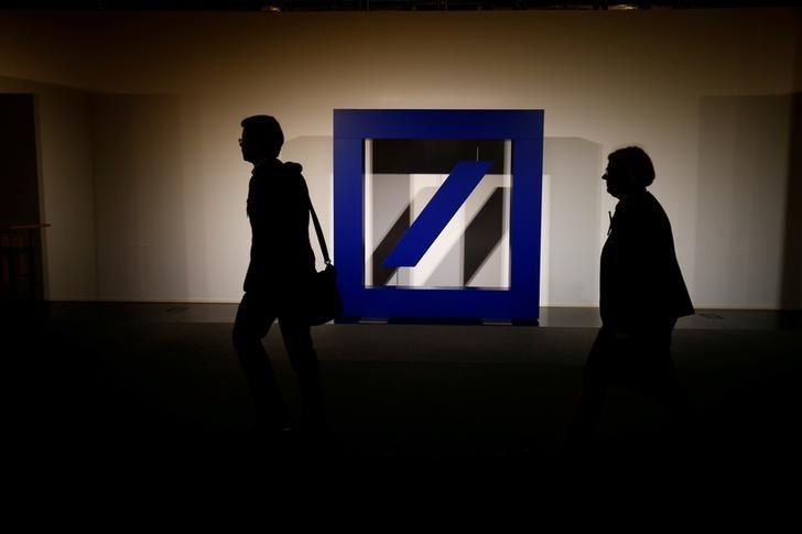 The logo of Deutsche Bank is seen at its headquarters ahead of the bank's annual general meeting in Frankfurt, Germany May 18, 2017. REUTERS/Ralph Orlowski/Files