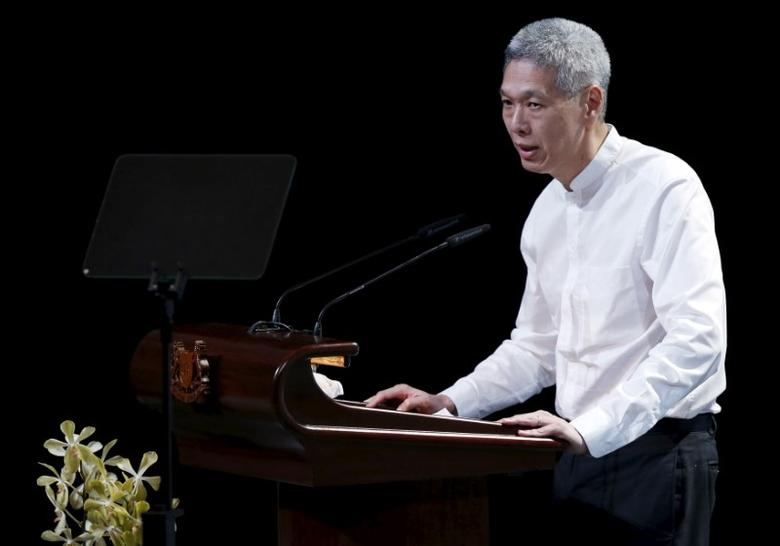 Lee Hsien Yang, son of former leader Lee Kuan Yew, delivers his eulogy during the funeral service at the University Cultural Centre at the National University of Singapore March 29, 2015.  REUTERS/Edgar Su